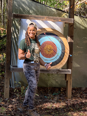 Woman Next to Archery Target