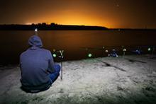 Man bank fishing at night