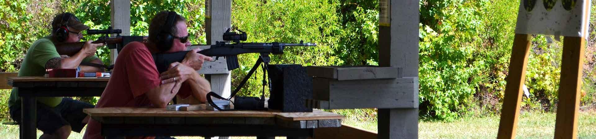man shooting firearm at range