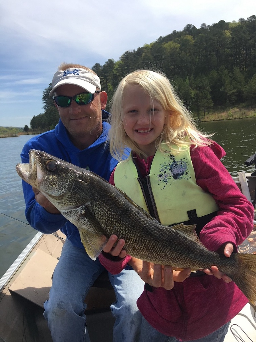 Girl and Dad Holding Walleye