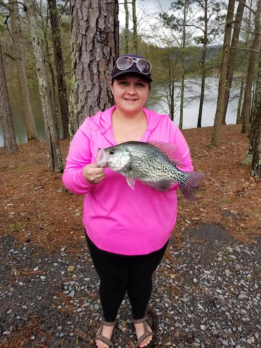 Woman Holding Black Crappie